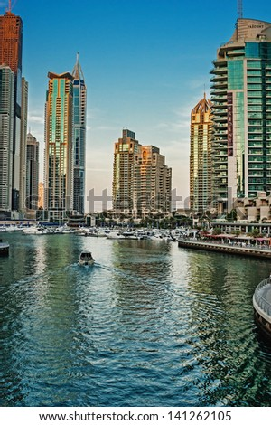 DUBAI, UAE - NOVEMBER 14: Modern buildings in Dubai Marina at sunset, on November 14, 2012, Dubai, UAE. In the city of artificial channel length of 3 kilometers along the Persian Gulf.