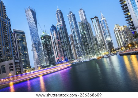 DUBAI, UAE - NOVEMBER 27: Modern buildings in Dubai Marina by night, Dubai, UAE. In the city of artificial channel length of 3 kilometers, taken on 27 November 2014 in Dubai.  - stock photo