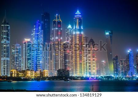 DUBAI, UAE - NOVEMBER 13: Modern buildings in Dubai Marina, Dubai, UAE. In the city of artificial channel length of 3 kilometers along the Persian Gulf, taken on 13 November 2012 in Dubai. - stock photo