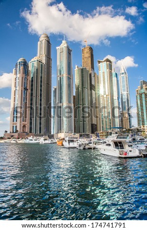 DUBAI, UAE - NOVEMBER 13: Modern buildings in Dubai Marina, Dubai, UAE. In the city of artificial channel length of 3 kilometers along the Persian Gulf, taken on 13 November 2013 in Dubai. - stock photo