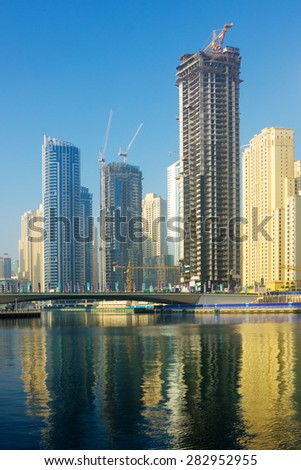 DUBAI, UAE - NOVEMBER 13: Modern buildings in Dubai Marina, on November 13, 2012, Dubai, UAE. Dubai was the fastest developing city in the world between 2002 and 2008.