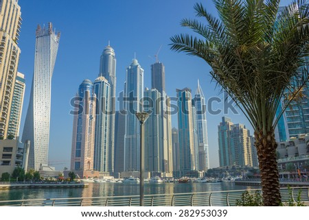 DUBAI, UAE - NOVEMBER 13: Modern buildings in Dubai Marina, on November 13, 2012, Dubai, UAE. Dubai was the fastest developing city in the world between 2002 and 2008. - stock photo