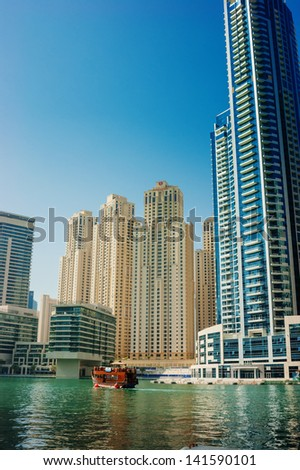 DUBAI, UAE - NOVEMBER 16: Modern buildings in Dubai Marina, on November 16, 2012, Dubai, UAE. In the city of artificial channel length of 3 kilometers along the Persian Gulf.