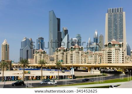 DUBAI, UAE - NOVEMBER 14: Modern buildings in Dubai, on November 14, 2012, Dubai, UAE. Dubai was the fastest developing city in the world between 2002 and 2008. - stock photo