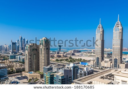 DUBAI, UAE - NOVEMBER 13: Modern skyscrapers in Dubai (emirate and city), UAE. Dubai now boasts more completed skyscrapers higher than 0,8 - 0,25 km than any other city on 13 November 2013  in Dubai. - stock photo