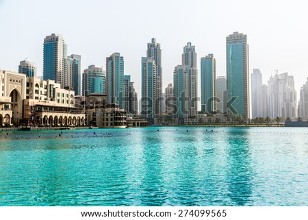 DUBAI, UAE - NOVEMBER 13: Modern skyscrapers in Dubai (emirate and city), UAE. Dubai now boasts more completed skyscrapers higher than 0,8 - 0,25 km than any other city  on 13 November 2012 in Dubai. - stock photo