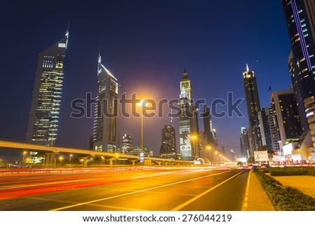 DUBAI, UAE - NOVEMBER 14: Modern skyscrapers, Sheikh zayed roads on November 14, 2013 in Dubai, United Arab Emirates. Dubai is the fastest growing city in the world. - stock photo