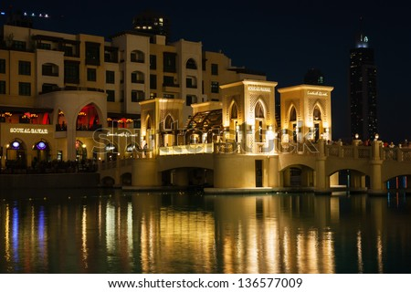 DUBAI, UAE - NOVEMBER 13: Night view Down town of Dubai city, on November 13, 2012, Dubai, UAE. In the city of artificial channel length of 3 kilometers along the Persian Gulf.