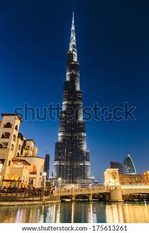 DUBAI, UAE-NOVEMBER 13: Night view of Burj Khalifa - the world's tallest tower at Downtown Burj Dubai on November 13, 2013 in Dubai, UAE - stock photo