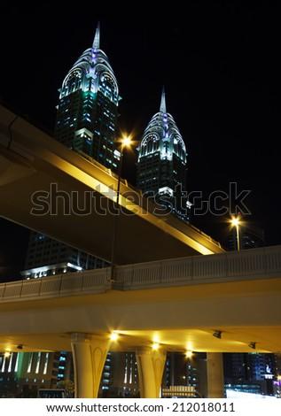 DUBAI, UAE-NOVEMBER 18: Night view of the Chrysler building in Dubai on November 18, 2012. Dubai builds two imitations of NYC Chrysler building. - stock photo