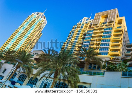 DUBAI, UAE - NOVEMBER 16: Nightlife in Dubai Marina. UAE. November 16, 2012. Dubai was the fastest developing city in the world between 2002 and 2008. - stock photo