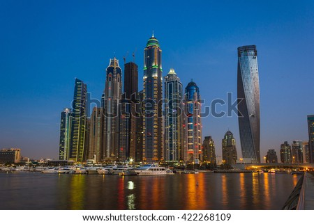 DUBAI, UAE - NOVEMBER 14: Nightlife in Dubai Marina. UAE. November 14, 2012. Dubai was the fastest developing city in the world between 2002 and 2008. - stock photo
