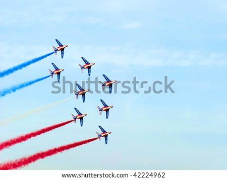 DUBAI, UAE - NOVEMBER 18: Patrouille De France, the French aerobatic team, performs during the Dubai Air Show 2009 in Dubai, United Arab Emirates - stock photo