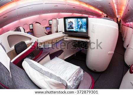 Dubai, UAE - NOVEMBER 10, 2015:  Qatar Airways Airbus A380 business class luxury seats. Qatar Airways business class. ORYX IFE system. Business class travelling on November 10, 2015 in Dubai - stock photo