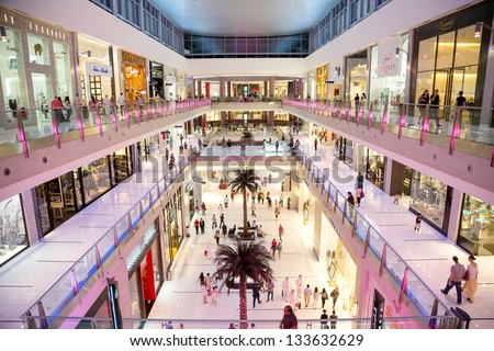 DUBAI, UAE - NOVEMBER 14: Shoppers at Dubai Mall on Nov 14 2012 in Dubai. At over 12 million sq ft, it is the world's largest shopping mall based on total area and 6th largest by gross leasable area. - stock photo
