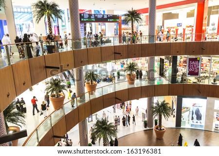 DUBAI, UAE - NOVEMBER 14: Shoppers at Dubai Mall on November 14, 2012 in Dubai. At over 12 million sq ft, it is the world's largest shopping mall - stock photo