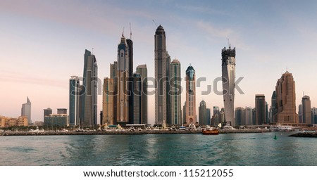 DUBAI, UAE - NOVEMBER 26: Skyscrapers in Dubai Marina at sunset, United Arab Emirates, Nov 26, 2011 Dubai is the most expensive city in the Middle East. - stock photo