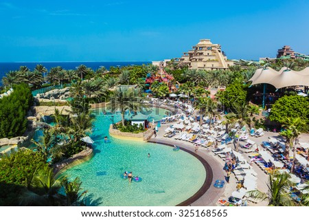 DUBAI, UAE - NOVEMBER 3: The Aquaventure waterpark of Atlantis the Palm hotel, located on man-made island Palm Jumeirah on November 3, 2013 in Dubai, UAE - stock photo