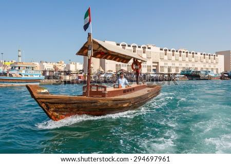 DUBAI, UAE-NOVEMBER 18, 2012: Traditional Abra ferries at the creek - stock photo