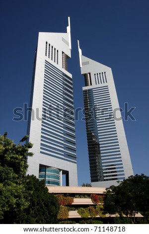 DUBAI, UAE - NOVEMBER 17: View at Emirates Towers in Dubai at November 17, 2010. This complex contains the Emirates Office Tower and Jumeirah Emirates Towers Hotel, which rise to 355 m and 309 m. - stock photo