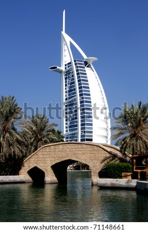 DUBAI, UAE - NOVEMBER 15: View at hotel Burj al Arab from Madinat Jumeirah in Dubai at November 15, 2010 Madinat Jumeirah encompasses two hotels and clusters of 29 traditional Arabic houses. - stock photo