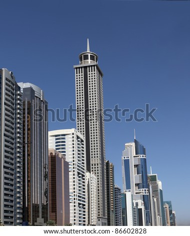 DUBAI, UAE - NOVEMBER 17: View at Sheikh Zayed Road skyscrapers in Dubai, UAE on November 17, 2010. More than 25 skyscrapers taller than 100 meters can be found there. - stock photo