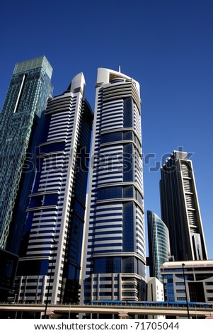 DUBAI, UAE - NOVEMBER 17: View of Sheikh Zayed Road skyscrapers in Dubai on November 17, 2010. More than 25 skyscrapers taller than 100 meters can be found there. - stock photo