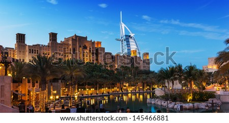 DUBAI, UAE - NOVEMBER 15: View of the hotel Burj Al Arab from Souk Madinat Jumeirah. Nov 15, 2012 in Dubai. Burj Al Arab is a luxury 7 stars hotel - stock photo