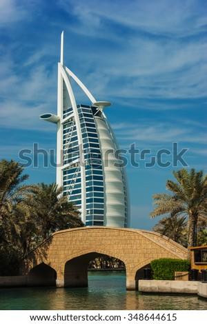 DUBAI, UAE - NOVEMBER 15: View of the hotel Burj Al Arab from Souk Madinat Jumeirah. Nov 15, 2012 in Dubai. Burj Al Arab is a luxury 7 stars hotel built  in front of Jumeirah beach. - stock photo