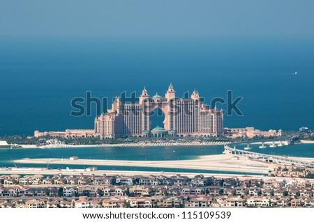 DUBAI, UAE - NOVEMBER 26: View on artificial island Palm Jumeirah and Atlantis hotel in Dubai, UAE on November 26, 2011. It is one of three islands called the Palm Islands at Dubai`s coastline. - stock photo