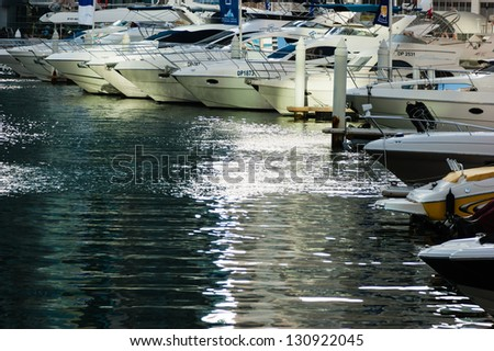 DUBAI, UAE - NOVEMBER 16: Yacht Club in Dubai Marina, on November 16, 2012, Dubai, UAE. In the city of artificial channel length of 3 kilometers along the Persian Gulf.
