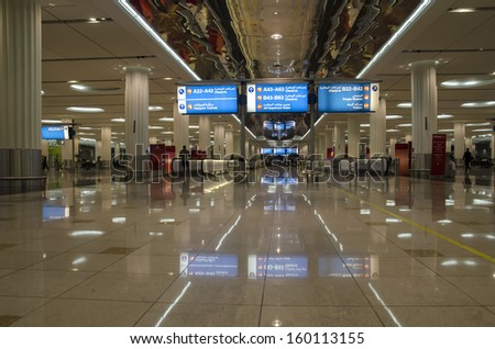 DUBAI, UAE - OCT 19: Dubai International Airport,where the photo was taken on 19 Oct 2013,  is a major airline hub in the Middle East and a big contributor to the Dubai economy.  - stock photo