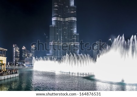 DUBAI, UAE - OCTOBER 1, 2012: A record-setting fountain system set on Burj Khalifa Lake - 6600 lights and 25 projectors, it shoots water 150 m into the air. United Arab Emirate. - stock photo