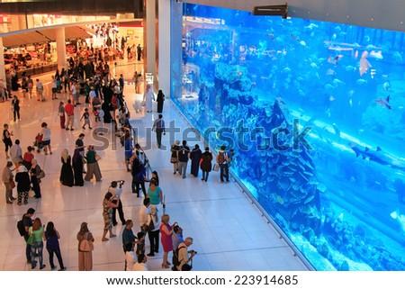 DUBAI, UAE - October 07, 2014 : Aquarium in Dubai Mall - world's largest shopping mall , Downtown Burj Dubai in Dubai, United Arab Emirates. People enjoying the beautiful view. - stock photo