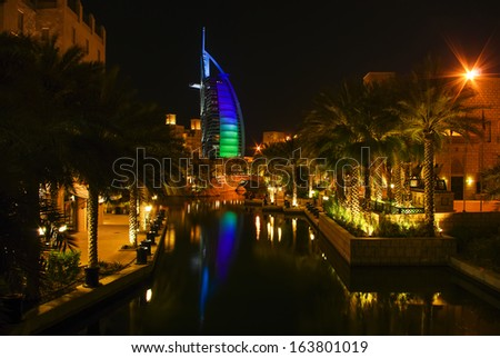 DUBAI, UAE - October 23: Burj Al Arab hotel by night on October 23, 2008 in Dubai, UAE. Burj Al Arab is a luxury 5 star hotel built on an artificial island in front of Jumeirah beach
