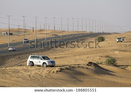 DUBAI, UAE - October 30 - Desert safari, also called dune bashing, in DUBAI, UAE on October 30, 2013. Desert safari is a popular activity among tourists in Dubai. - stock photo