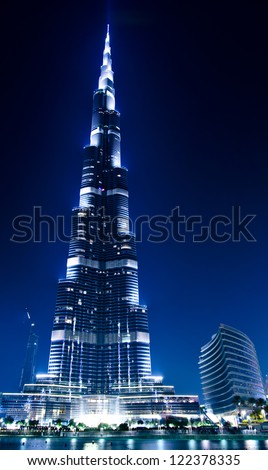 DUBAI, UAE - OCTOBER 11: Dubai downtown and Burj Khalifa on October 11, 2012 in Dubai, UAE. Burj Khalifa is a tallest building in the world, at 828m. Located on Sheikh Zayed Road,United Arab Emirates. - stock photo