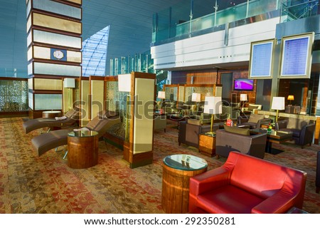 DUBAI, UAE - OCTOBER 17, 2013: Emirates business class lounge interior. Emirates is the largest airline in the Middle East, operating from its hub at Dubai International Airport - stock photo