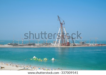 Dubai, UAE - October 02: Jumeirah beach in Dubai, UAE on October 02 2015. is a white sand beach that is located and named after the Jumeirah district of Dubai. - stock photo
