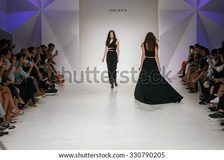DUBAI, UAE - OCTOBER 23, 2015: Model walk runway at the Fatema Fardan Runway show during  Fashion Forward Dubai : Spring / Summer 2016 at Madinat Jumeirah, Dubai - stock photo