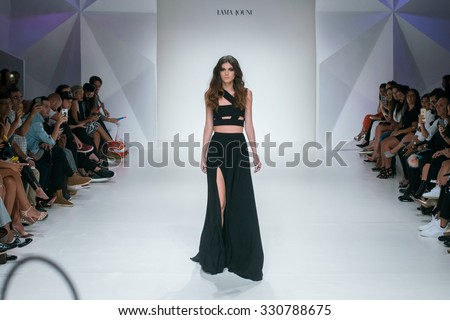 DUBAI, UAE - OCTOBER 23, 2015: Model walk runway at the Lama Jouni Runway show during  Fashion Forward Dubai : Spring / Summer 2016 at Madinat Jumeirah, Dubai - stock photo