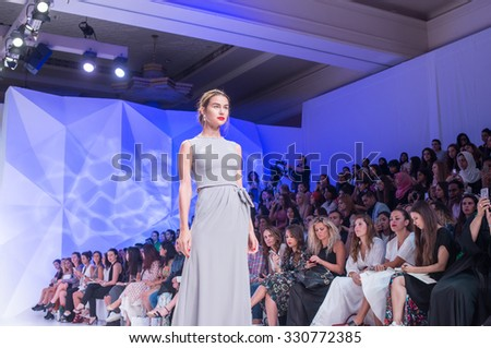DUBAI, UAE - OCTOBER 23, 2015: Model walk ruway at the  Fatema Fardan Runway show during 