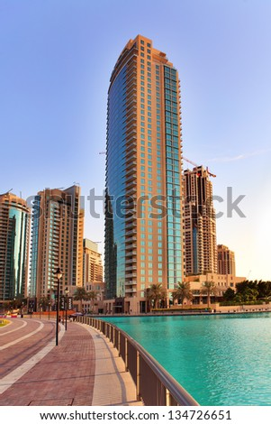DUBAI, UAE - OCTOBER 23: Modern skyscrapers in Dubai on October 23, 2012 in Dubai, UAE. Dubai now boasts more completed skyscrapers higher than 0,8 - 0,25 km than any other city - stock photo