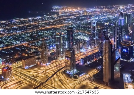 DUBAI, UAE - OCTOBER 1, 2012: Night view Down town of Dubai city from Burj Khalifa. United Arab Emirates. - stock photo