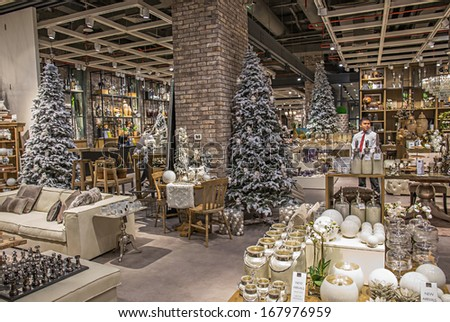 DUBAI, UAE - OCTOBER 31: Shop Christmas gifts in Dubai mall on October 31, 2013 in Dubai. At over 12 million sq ft, it is the world's largest shopping mall based on total area. - stock photo