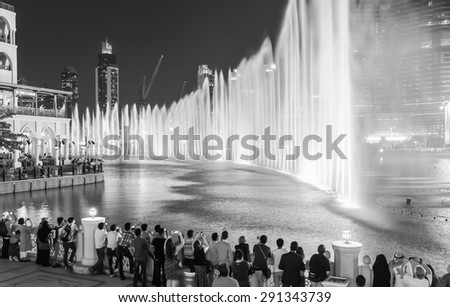 DUBAI, UAE - OCTOBER 15, 2014: The Dubai Fountain. The Dubai Fountain is the world's largest choreographed fountain system set on the 30-acre manmade Burj Khalifa Lake - stock photo
