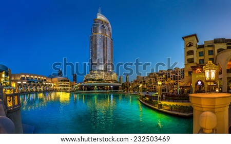 DUBAI, UAE - OCTOBER 19: The Dubai Mall and The Address Hotel at Dusk on October 19, 2014 in Dubai, UAE. The Dubai Mall is the largest shopping mall in the world with some 1200 stores - stock photo