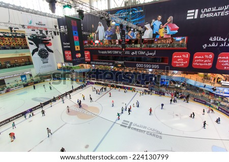 DUBAI, UAE - October 07, 2014: The ice rink of the Dubai Mall in Dubai, UAE. Dubai Mall is the largest shopping mall in the world with some 1200 stores - stock photo