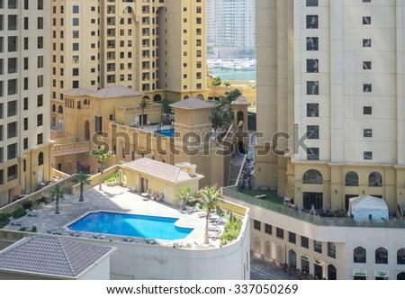Dubai, UAE - October 02: Urban landscape of Dubai, UAE on October 02 2015. Dubai is is the most populous city in the United Arab Emirates popular by its luxury resorts. - stock photo