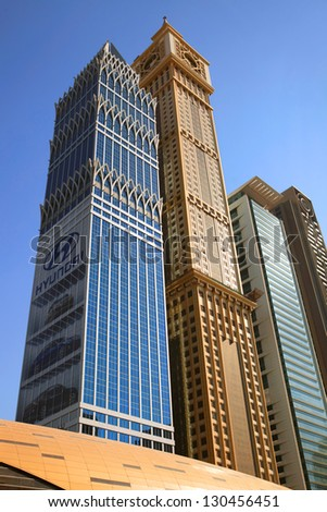 DUBAI, UAE - OCTOBER 23: View at Sheikh Zayed Road skyscrapers in Dubai on October 23, 2012. More than 25 skyscrapers taller than 100 meters can be found here. - stock photo